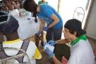 Volunteers conducting diabetes screening tests