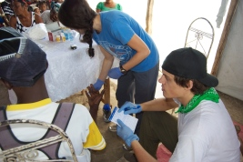 Volunteers conducting diabetes screening tests