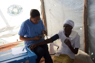HGD Nurse checking vital signs