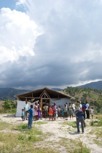 Patients line up and wait outside the mobile health clinic