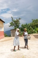 Two satisfied patients leaving the mobile clinic